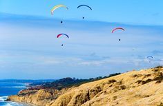 Grab a picnic lunch and head to Torrey Pines Gliderport for a perfect photo opp overlooking the ocean. It's near the famous Torrey Pines Golf Course and UC San Diego.