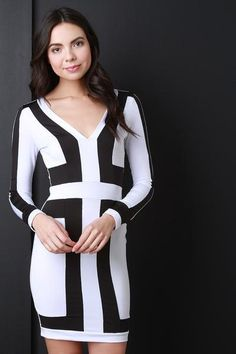 Long Sleeve Colorblock Bodycon Dress - This colorblock dress features a v-neckline, long sleeves and a two tone color design. Finished with a sculpture fit and a mini hemline. Accessories sold separately. Made in U.S.A. 92% Polyester, 8% Spandex.  Topaze Fashion