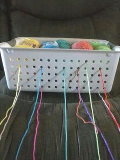 Brilliant idea - will have to try this some time - saw this as an idea for rolls of ribbon, never thought of using it for yarn!!!