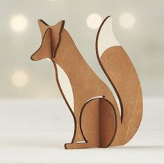Laser-cut wood pieces assemble into a dimensional, freestanding fox for individual display or as part of woodland scene with other objects in our laser-cut wood collection.  Pieces slide apart and stack for flat storage in a reusable box. PlywoodMade in China.