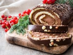 Traditionally served at Christmas in France, this sweet chocolate roulade is perfect for an Australian Christmas dessert. Winter Sangria, Chocolate Roulade, Desserts Around The World, Yule Log Cake, Cake Stock, Christmas Cooking, Christmas Desserts, Christmas Cakes, Yummy Food
