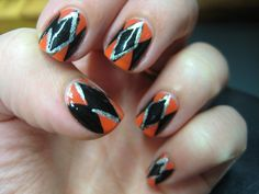 Pin for Later: 25 Cute and Creepy Nail Art Ideas For Halloween  This black, orange, and silver manicure is great on its own or as an accent to any harlequin ensemble. Source: Flicker user lulubrooks