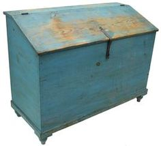"""Lebanon County, Pennsylvania 19th Century Pine Feed Chest with Original Blue Paint. Hinged slant-lid with original iron hasp, compartmented interior, dovetailed case, molded base and turned turnip feet. Found at the original farmhouse in Milbach, Lebanon Co., PA. 36""""h x 47 1/4""""w x 21""""d. Condition: good with expected wear, all original."""