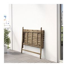 IKEA ASKHOLMEN table folds flat