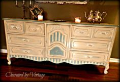 French dresser. The top was done with a custom mixed blue first and then Old Ochre. Then it was distressed to let the blue peak through. - Charmed by Vintage