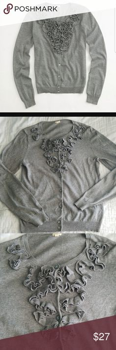 J. Crew Factory Ruffled Cardigan J. Crew Factory Ruffled Cardigan  *Grey cardigan sweater with ruffled detailing on the neckline and down the chest *Pearlized, grey buttons (Extra button sewn on the inside) *100% Cotton  *Size Medium *Excellent pre-owned condition!  ☆☆Bundle with other items in my closet and save!! All reasonable offers accepted! J. Crew Factory Sweaters Cardigans