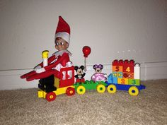 "Day ""Belle"" the Elf on the Shelf conducting the Lego Duplo Mickey Mouse Clubhouse Parade Train Mickey Mouse Clubhouse, Christmas Elf, Christmas Crafts, Xmas, The Elf, Elf On The Shelf, Lego Trains, Lego Duplo, Navidad"
