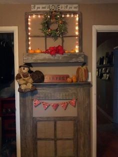 Our latest pallet fun...a faux mantel and window in our bedroom.  The burlap backing disguises our cold air vent, which made this tiny wall a challenge.  The vintage window planter box above was a $20 thrift shop find a few years ago, and the textures on all pieces are wonderful!  So tickled to have a mantel again to play with for the seasons!