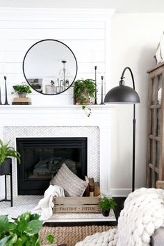 Black Swing arm lamp and a modern farmhouse fireplace. Spring Living Room Update with HomeGoods- Modern Farmhouse Living Room by Plum Pretty Decor Design Co.