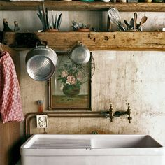 Rustic kitchen with exposed pipes...love the look... by Ticking and Toile