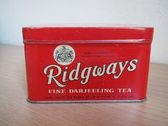 """Ridgways Fine Darjeeling Tea tin ... red rectangular chest shape w/ royal warrant and """"By Appointment to Her Majesty The Queen"""" on front and lid, c. 1950s-1960s, UK"""