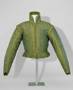 Doublet - 16th c.  (Chest 30 cm, tabs 6 cm. / Green brownish iridescent silk doublet (blue warp, golden yellow weft), Pinking in a square pattern. Collar rising towards the back, no closure. 19 thread buttons at the front, 6 on each sleeve, close together. Horizontal waist, with 12 trapezoid tabs. At the shoulders wings, not padded. The sleeves narrow evenly towards the wrist. Canvas lining, and where the lining is visible, green silk. Collar lining blue silk. According to Fries, new.)