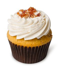 Dude's Maple Bacon – A dude's (and dad's) delight! A light cinnamon maple cupcake with bacon folded into the batter, topped with a light cinnamon vanilla buttercream and pieces of real bacon.