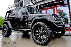 Jeep Wrangler Sport with 22inc wheels...this is what I'm wanting for our play vehicle, just trying to decide if I want white or black haha!