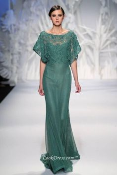 Illusion long green evening dress with lace appliques on top for casual style, bateau neck features and flutter sleeves flares. Flowy layered skirt is designed to skim the floor elegantly and naturally.