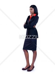 businesswoman with arms crossed looking away. - Young African American businesswoman with arms crossed looking away over white background, Model: Vanessa Mitchelle