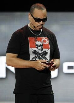 Ice-T plays 'Gears of War 3' at the Microsoft Xbox global media briefing during the E3 gaming convention in Los Angeles, Monday, June 6, 2011.