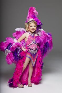"""It is estimated that 250,000 children compete in more than 5,000 pageants across the United States each year. The world of child pageants has reemerged on the pop culture scene with the popularity—and shock— of the TLC reality series, """"Toddlers and Tiaras."""" The show, now in its fourth and final season, documents contestants and their families as they prepare for pageant shows across the country. Girls Short Dresses, Dresses For Tweens, Old Dresses, Cute Dresses, Glitz Pageant Dresses, Pageant Wear, Toddler Pageant, Dance Recital Costumes, Toddlers And Tiaras"""