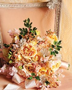Bouquet with Lace Trimmings    This soft-hued mound of peach garden roses, ballet-pink sweet peas, and enkianthus almost runs the risk of being too old-fashioned. But by adding some trimmings from your veil -- like little bits of lace, shiny ribbon, or these shimmery silver rosettes -- the bouquet becomes not only refreshingly whimsical, it also happens to completely pull together your wedding day ensemble.