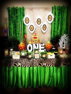 Dessert table at a Safari Jungle Party Jungle Theme Parties, Safari Theme Party, Safari Birthday Party, Jungle Party, First Birthday Parties, Birthday Ideas, Lion King Party, Lion King Birthday, Madagascar Party