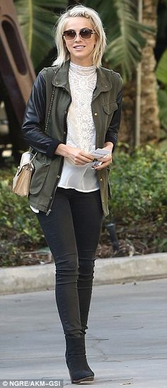 Keeping it casual: The 24-year-old wore a khaki jacket which featured leather sleeves with a white blouse, jeans and ankle boots
