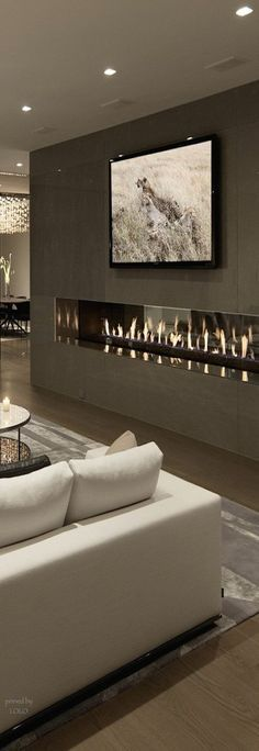 Contemporary gray smooth stone Fireplace . I love fuel oil fireplaces!