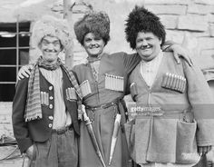 From left to right, Stan Laurel (1890 - 1965), Lawrence Tibbett (1896 - 1960) and Oliver Hardy (1892 - 1957) dressed as Russians for their roles in 'The Rogue Song', directed by Lionel Barrymore and Hal Roach.