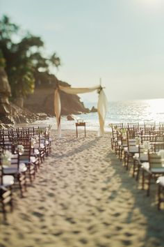 A lovely beach wedding setup via Style Me Pretty #beachwedding