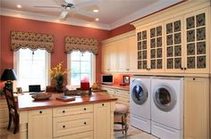 Light Traditional Laundry Room/ office combo