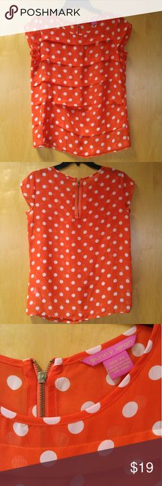 """Sunny Leigh Orange Blouse with White Polka Dots Sunny Leigh brand blouse from Macy's, size XS extra small, in great condition! Only flaw is the stitching has come out of one of the horizontal pleats in the fabric (see 1st and 4th photo). Could be worn as is since its not that noticeable but I also think it'd be an easy fix. Sheer and has zipper at back of neck. No stretch. Measurements are 18"""" pit to pit and 23"""" shoulder to bottom hem. Please ask any questions. No trades. Make a reasonable…"""