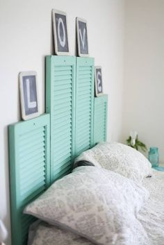 Love the shutters as a headboard. Thinking about convincing the bf to let me do this.