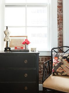 black vintage dresser and black bamboo chair