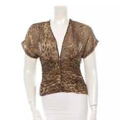 """Swarovski buttons! Tuleh silk leopard top TULEH TOP - I would keep but I'm just not a leopard print girl. Super flattering design for any figure - Bryan Bradley knew how to cut a shirt! To make a lady look good!     XS, couture made in NYC Item is a model sample from runway show, worn only for a few minutes. Beige and brown Tuleh leopard print short sleeve ruched top with brown Swarovski glass buttons at front. Condition:Excellent Size: XS Measurements:Bust 32"""", Waist 26"""", Length 22""""…"""