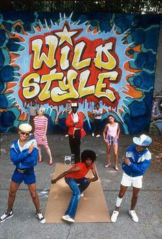 Wild Style mural by Zephyr, Revolt, Sharp. front row: Doze, Frosty Freeze, Ken Swift; middle row: Patti Astor, Fred Brathwaite, Lady Pink; back row: Lil Crazy Legs, Revolt and Sharp; directed by Charlie Ahearn, photo by Martha Cooper.  1983