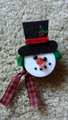 Snowman made with tea light. I put a magnet on the back so you can put it on the refrigerator.
