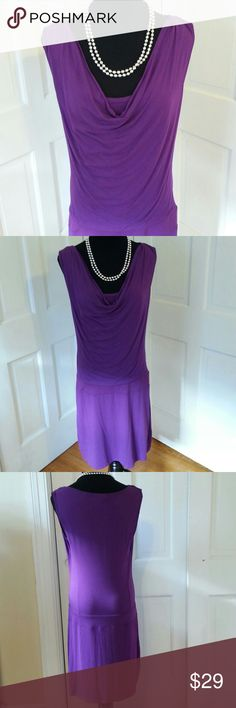 NEW YORK COMPANY STRETCH S PURPLE BEAUTIFUL PURPLE DRESS DESIGNED BY NEW YORK COMPANY STRETCH SIZE S. DRESS IS DESIGNED SLEEVELESS WITH BEAUTIFUL COWL DROP NECK AND DROP WAIST. ONE OF THOSE COMY DRESSES YOU WANT TO WEAR EVERY DAY. JUST NOT MY SIZE. IT WAS MY DAUGHTERS, BUT SHE IS NOW INTO JEANS AND FLIPFLOPS. VERY LIGHTLY WORN. New York & Company Dresses Mini