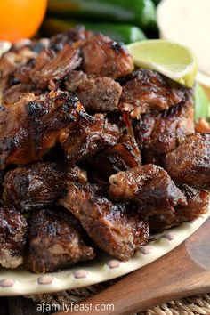 Carnitas - Perfect for Cinco de Mayo parties!!  Bite-sized pieces of pork cooked low & slow in the oven until super tender, then perfectly caramelized! So good!