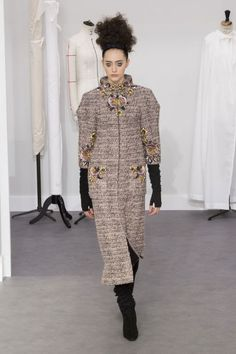 A stunning floral emboidered floor-length tweed coat seen at the Chanel Fall 2016 Couture Show in Paris, France.