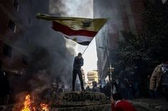 A Protestor waving Rabaa Al-Adawiya Flag along with the Egyptian Flag against the Military. #R4BIA