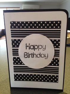 One of my friends birthday cards made by me.  Washi tape, circle cut die, black embossing powder.