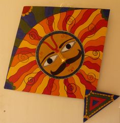 This is another hand painted wooden kite with a Madhubani inspired motif of the Sun. Madhubani Art, Madhubani Painting, Kite Decoration, Decorations, Phad Painting, Christmas Art For Kids, Kite Designs, Kite Making, Art Storage