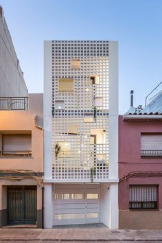 World Architecture Community News - Viraje arquitectura creates perforated façade for elongated family house to play with natural light Brick Facade, Facade House, Stone Facade, House Facades, Facade Design, Exterior Design, Townhouse Designs, Narrow House, Small Buildings