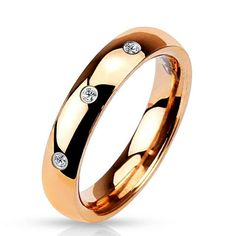 Featuring: * 3 Clear Stones of Cubic Zirconia * Classic Dome Band * Rose Gold Ion Plated * Metal: Stainless Steel * Wedding Band *Women's Ring * Width: Stainless Steel Wedding Bands, Stainless Steel Jewelry, 316l Stainless Steel, Gold Body Jewellery, Gold Jewelry, Wholesale Body Jewelry, Titanium Jewelry, Diamond Wedding Bands, Wedding Rings