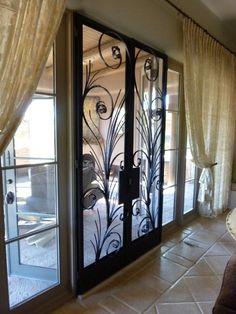 Wrought Iron Screen Doors.