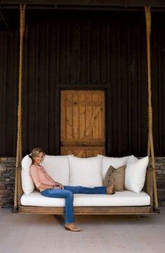 Photo Credit: Hollis Bennett. Interior designer Rachel Halvorson kicks back at the guest house she designed for country musician Ronnie Dunn outside of Nashville, Tennessee