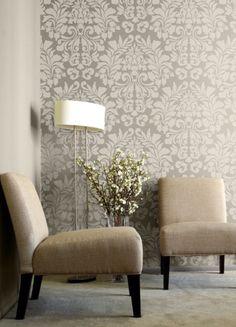 Brocade, damask wallpaper with modern furniture.