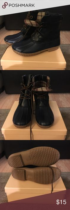 Yoki two-tone duck boots A cute rain boot adds a matte shade to a two-tone look with a textured sole and a lace-up closure.  With a man-made upper and sole textured outsole contrasting shaft, lace up closure *worn once* Yoki Shoes Winter & Rain Boots