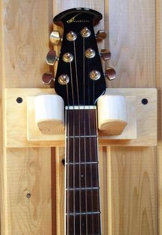 Made of pine, this guitar holder is a beautiful hanger for your Guitar so it can stay safe and look great! Dimensions: Hanger Neck Width - 1