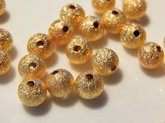 Gold Plated Brass Stardust Beads    Product Details  ~~~~~~~~~~~  Size: 8mm  Hole:1.5mm Shape: Round  Material: Brass Color: Gold  Other: Nickle