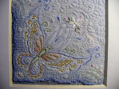 From vintage linen hankie corner hand beaded and machine quilted